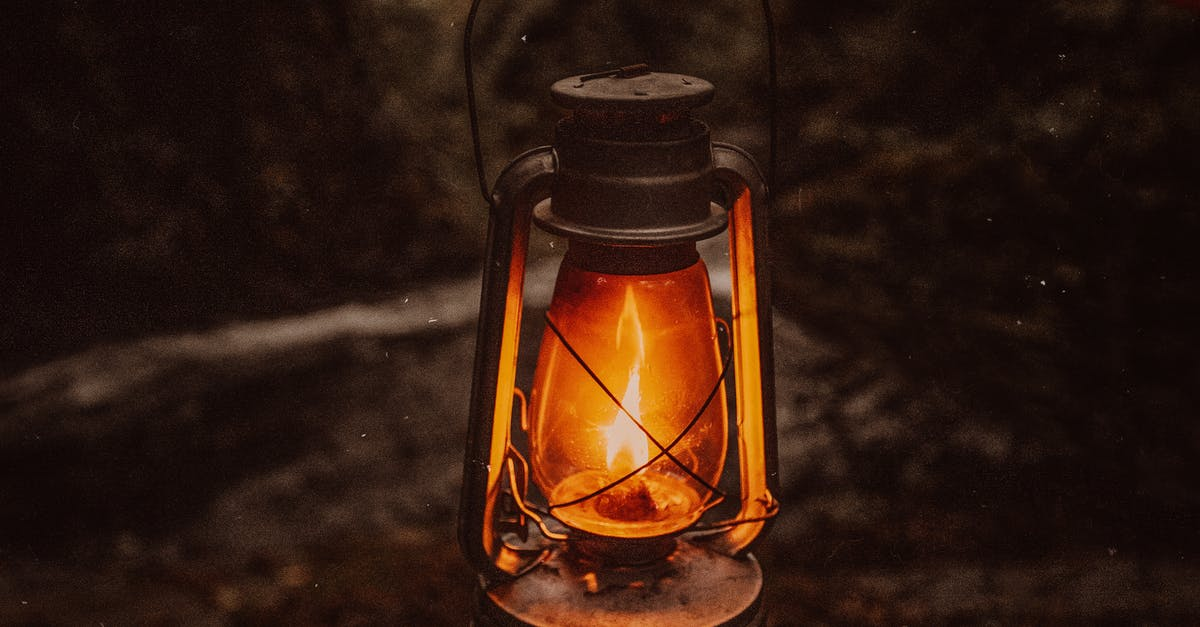 A close up of a glass lamp on a table