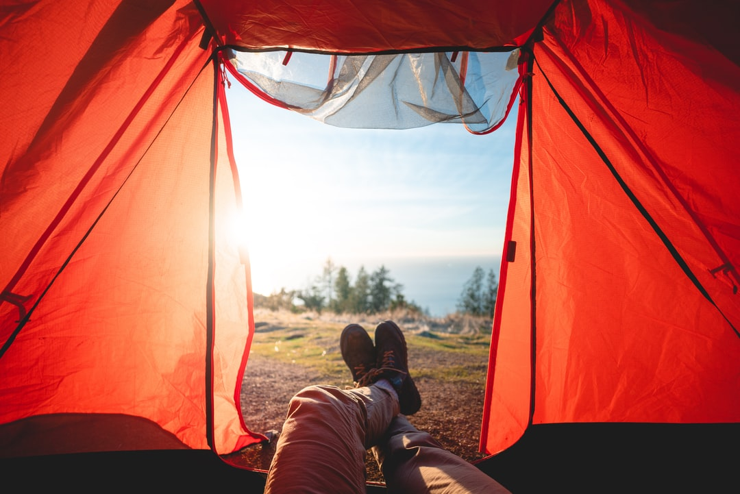 A man sitting in a tent